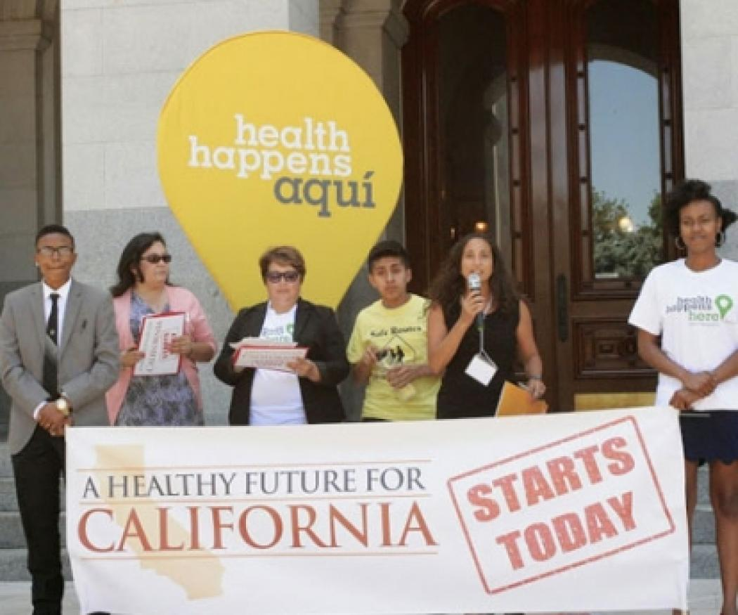 """Rally leaders with a sign that says """"A Healthy Future for California"""""""